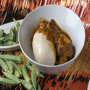 Banku with okra stew (with meat)